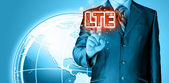 Pushing finger on lte button — Stock Photo