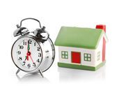 House and clock — Stock Photo