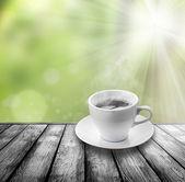 Caffè sul pavimento in legno — Foto Stock