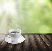 Coffee on wood floor — Stock Photo