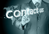 Businessman hand pushing contact us button — Stock Photo