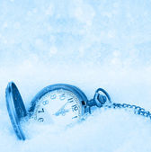 Pocket watch on a snow background — 图库照片