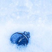 Pocket watch on a snow background — Stock Photo