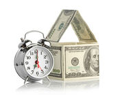 House made of dollars and alarm clock — Stock Photo