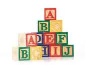 Wooden cube alphabet — Stock Photo