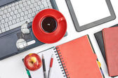 Laptop and office supplies on white — Stock Photo