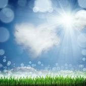 Lente aard achtergrond met gras en blauwe hemel in de rug — Stockfoto