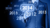 Businessman touching new year 2014 — Stock Photo