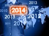 新しい 2014 年までに触れる実業家 — ストック写真