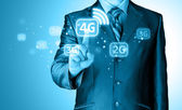 Businessman pushing 4g — Stock Photo