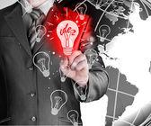 Tocar a luz da idéia do homem de negócios — Foto Stock