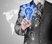 Business man touching light of idea — Stockfoto