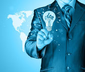 Business man touching light of idea — Zdjęcie stockowe