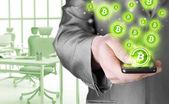 Phone and bitcoin symbol — Stock Photo