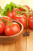 Tomatoes in bowl — Stock Photo