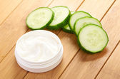 Face mask with cucumber slices — Stock Photo