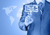 Businessman is pushing his finger on lte button — Foto Stock