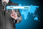 Businessman pushing virtual search bar — Stock Photo