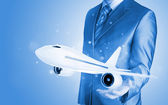 Businessman with airplane — Stock Photo