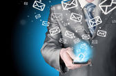 Business man sending emails — Stok fotoğraf