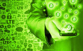 Hand with mobile smart phone and bitcoin symbol — Stock Photo