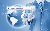 Businessman and crowd funding words — Stock Photo