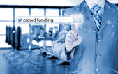 Businessman and crowdfunding in search bar — Stock Photo