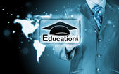 Businessman pointing 'education' sign — Stock Photo