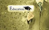 Businessman pointing 'education' concept — Stockfoto