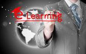 Businessman writing e-learning — Stock Photo