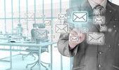 Businessman pushing on virtual email. — Stock Photo