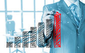 Businessman drawing a growing graph — Stock Photo