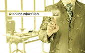 "Businessman pushing  ""Online education"" — Stock Photo"