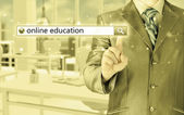 "Businessman pushing  ""Online education"" — Stock Photo"