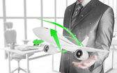 Businessman with airplane over his hand — Stock Photo