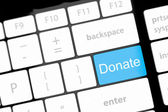 Donate key word on computer keyboard, — Stock Photo
