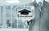 Business man pointing education concept — Stock fotografie