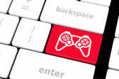 Computer keyboard with  icon game pad — Stock Photo