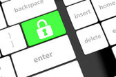 Enter button with Closed Padlock on computer keyboard background — Stock Photo