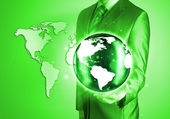 Businessman holds Earth in a hand — Stock Photo