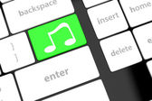 Computer keyboard with icon music — Stock Photo