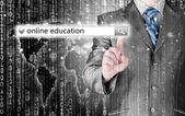 Online education written in search bar on virtual screen. — Stock Photo
