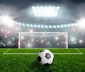 Soccer ball on green stadium arena — Stock Photo
