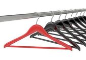 Black and red clothes hangers — ストック写真