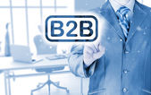 Businessman pointing to word B2B — Stock Photo