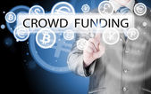 Businessman pushes virtual crowd funding button — Stock Photo