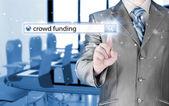 Hombre de negocios y el financiamiento público en la barra de búsqueda — Foto de Stock