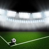 Bola de futebol no canto de campo verde — Fotografia Stock
