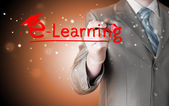Business man writing e-learning concept — Stockfoto