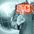 Businessman is pushing his finger on lte button — Stockfoto